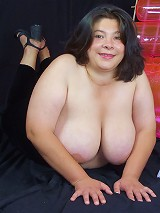 Live clip of a pretty young BBW model taking off her top to play with her huge fat tits